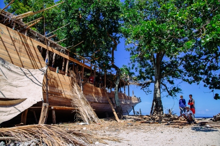 A traditional Indonesia wooden ship under construction on the beach. Indonesia, June 2014.