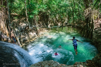 Local kids cool off in the jungle waterfall and pool in Sumbawa, Indonesia, June 2014.