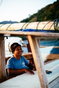 Our smiling boat captain takes a short break from navigating the 24-meter Lombo during our week-long live aboard in Komodo. Indonesia, June 2014.