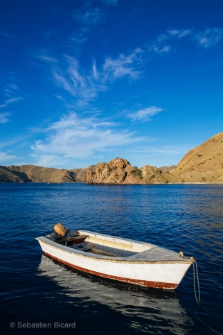 Our speed boat awaits our next dive in the azure waters of Komodo National Park. Indonesia, June 2014.