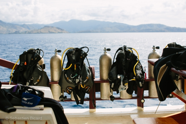 Our BCDs (buoyancy control devices), air tanks and other equipment on board awaiting our next dive. Scuba requires a lot of technical 'stuff'.