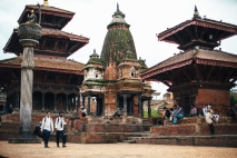Students, tourists and locals pass through Patan's historic Durbar Square outside of Kathmandu. Nepal, July 2014.