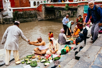 Families come to pay their respects to their beloved deceased on the anniversaries of the cremations in the sacred Hindu site of Pashupatinath. Nepal, July 2014.